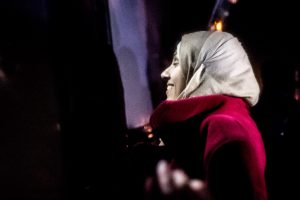 LESVOS - A Syrian woman enters the bus while smiling because of relief.