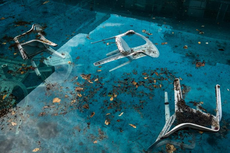 Mati, Athens, Greece, | November 28, 2018 | Photo #5 | Many people have died in the sea while trying to flee the fires. Here a couple of plastic chairs are floating in the swimming pool of an abandoned apartment building facing the sea. Photo: Joris van Gennip