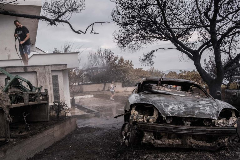 Mati, Athens, Greece, | November 28, 2018 | Photo #2 | A home-owner is cleaning his severely damaged house, a week after the forest fires destroyed most of the small coastal town of Mati. Photo: Joris van Gennip