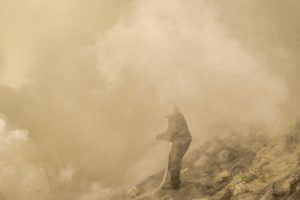 Being fully covered by sulfur fumes is incredibly dangerous. Workers doing this work often wear protection.