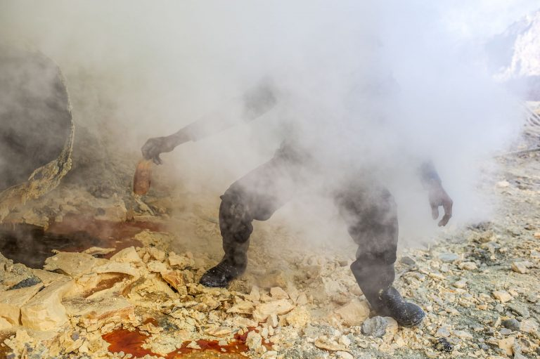 This is a typical sight of a miner collecting sulfur. Although the fumes are really dangerous to your health, they do not wear protecting. A gasmask is expensive.