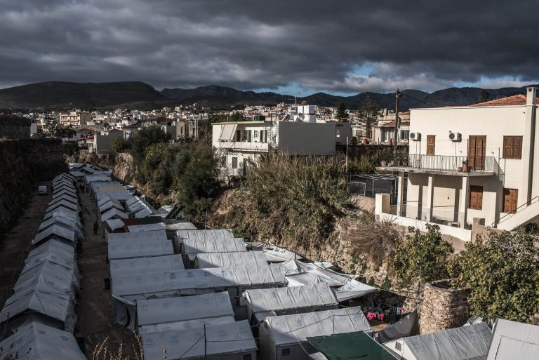 "On the 18th of november 2016, a far-right mob attacked the volunteer run Souda camp (seen on this photo). The assailants threw petrol bombs, fireworks and stones and assaulted some of the volunteers leaving some injured and damaging one of the tents. The Aegean islands are home to around 10 000 refugees and migrants from all over the world. Since the `EU-Turkey Refugee Deal` the influx has been decreased but not stopped. This causes tensions to a part of the Chios population and the refugees/immigrants. A German couple who owned a holiday house on the eastern part told me ""In the beginning they would come and go quickly so we helped them. Now they are staying, we don't want that""."
