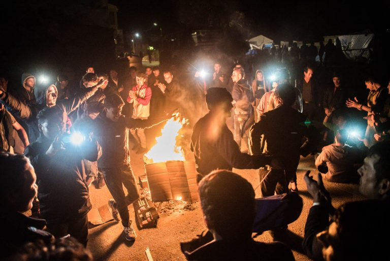 "After a group of Algerians attacked a group of Afghans and the Afghans scared them away, they made a campfire in front of the police and danced around it ""To show that we are a peaceful people"" ."