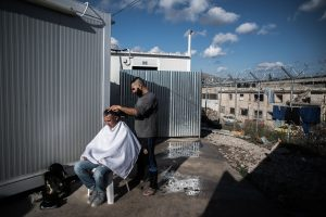"Hairdresser from Syria doing his job ""I don't want food or clothes, i want a life""."