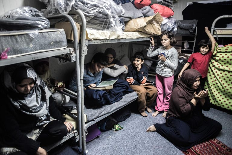 After the Taliban killed 8 of their family in Pakistan, they decided it was time to leave the country and head off to Europe. Highly educated as they are, they have been inside this container for around 9 months already. Their children haven't gotten any education for 2 years. They speak fluent English.
