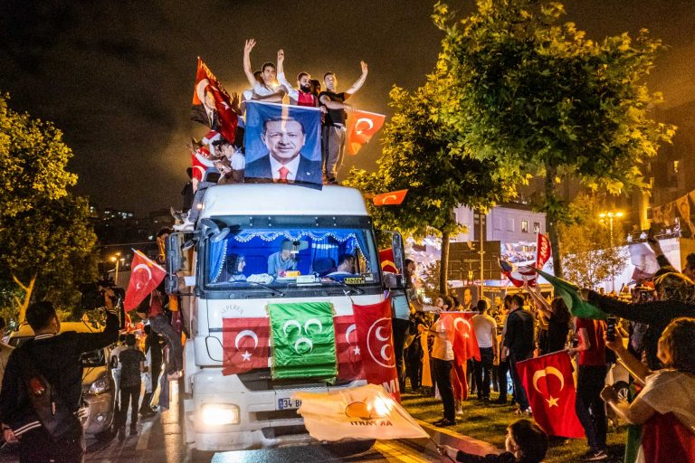 Istanbul, Turkey, June 24, 2018 | PHOTO #7 | AKP supporters Celebrating Erdogan's victory during the 2018 elections in front of the AKP headquarters in Istanbul by holding a portrait of Erdogan while sitting on a truck.  Photo: Joris van Gennip
