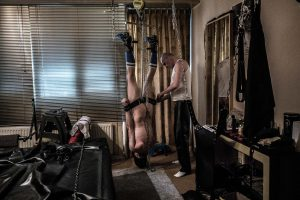 This is the sight of the ending of the 2 hour long session between Rajko, a 56 year old BDSM master and his slave Nescio. Being haang upside down, naked and enchained this is the ultimate form of loosing control.